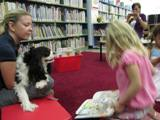 Photo of Pup-a-Roo the dog reading