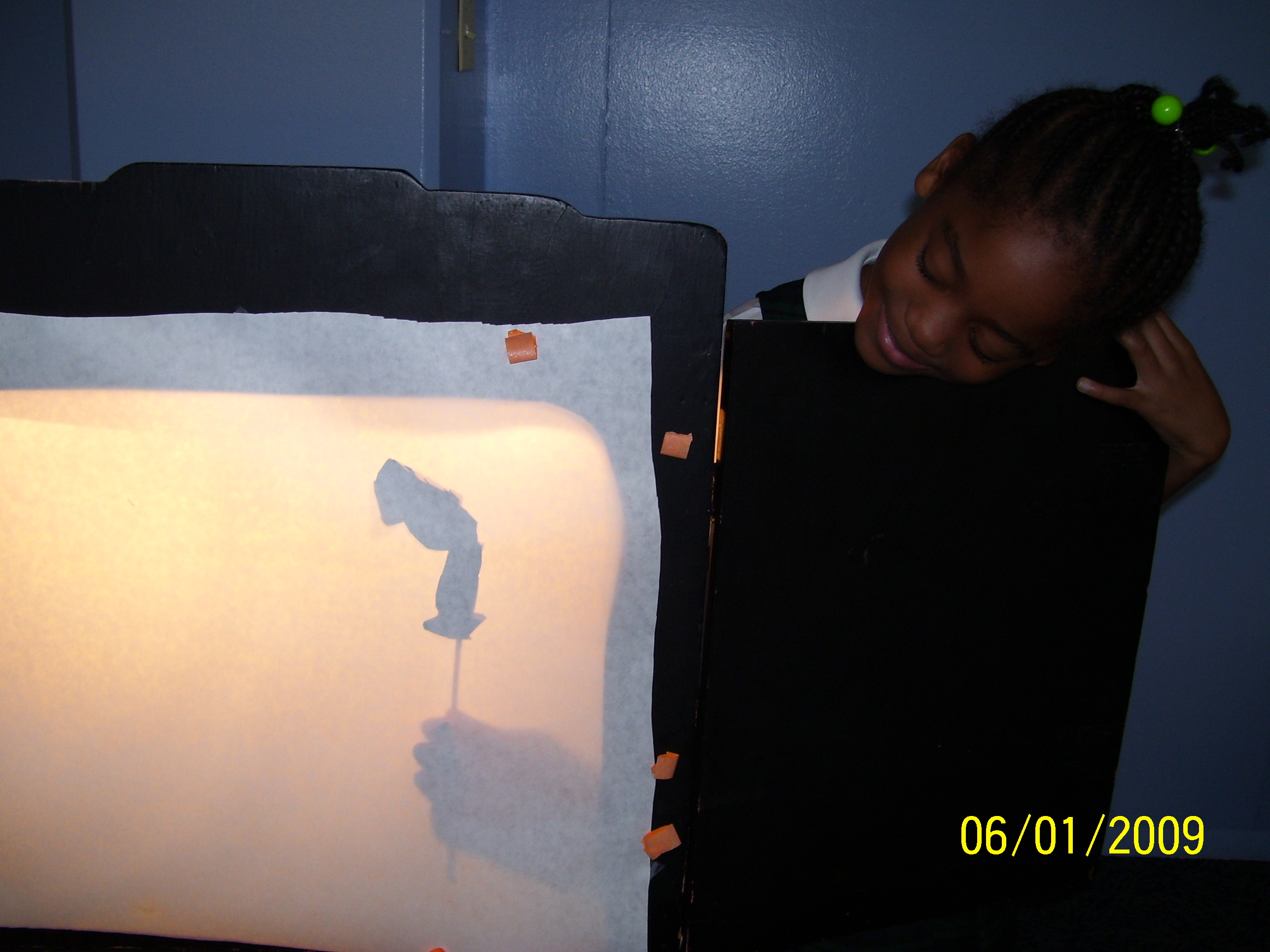 A Rusalka puppet gets a whirl in the shadow theater.