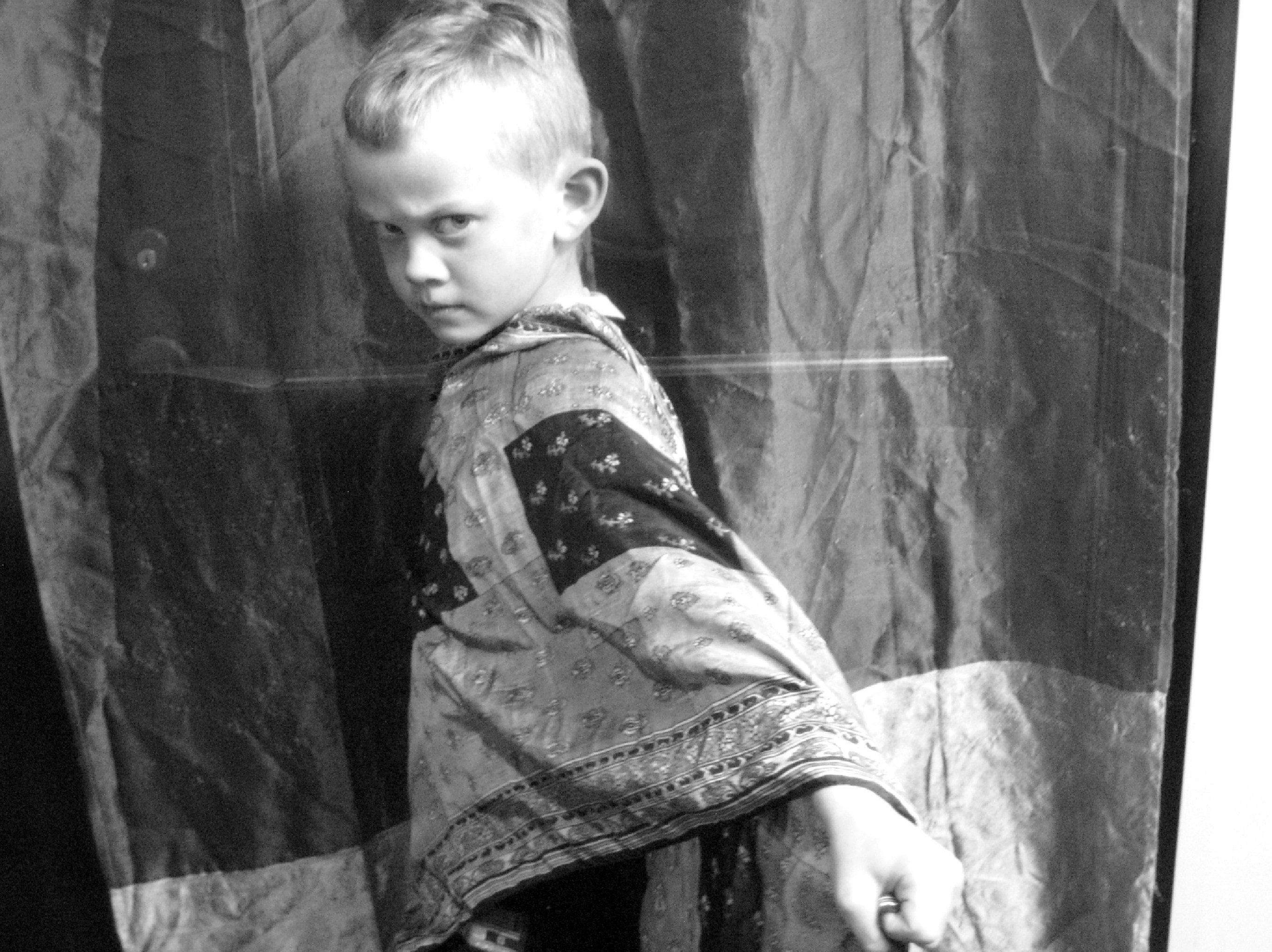 Boy posing in the style of silent movie
