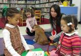 Aubrey the dog and the girls reading books at the library
