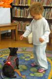 Photo of Ava practicing a trick at the library