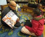 Photo of Ava enjoying a good doggie story at the library