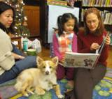 Photo of Bailey the dog listening to stories at the library
