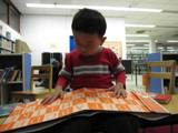 Boy reading a book at the library