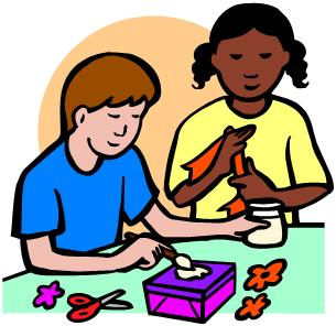 A boy and girl doing arts and crafts