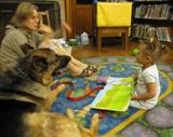 Photo of Dakota the dog reading with a girl