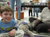 Photo of Ella the dog and a boy at the library