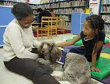 Photo of Ella the dog and a girl at the library