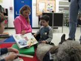 Photo of Ella the dog and a boy reading with his Mom