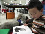 Photo of Ella the dog reading with a boy