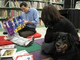 Photo of Happy the dog reading in the library
