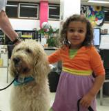 Photo of Harpo the Dog and a little girl at the library