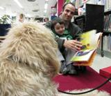 Photo of Harpo the dog listeing to a father and son