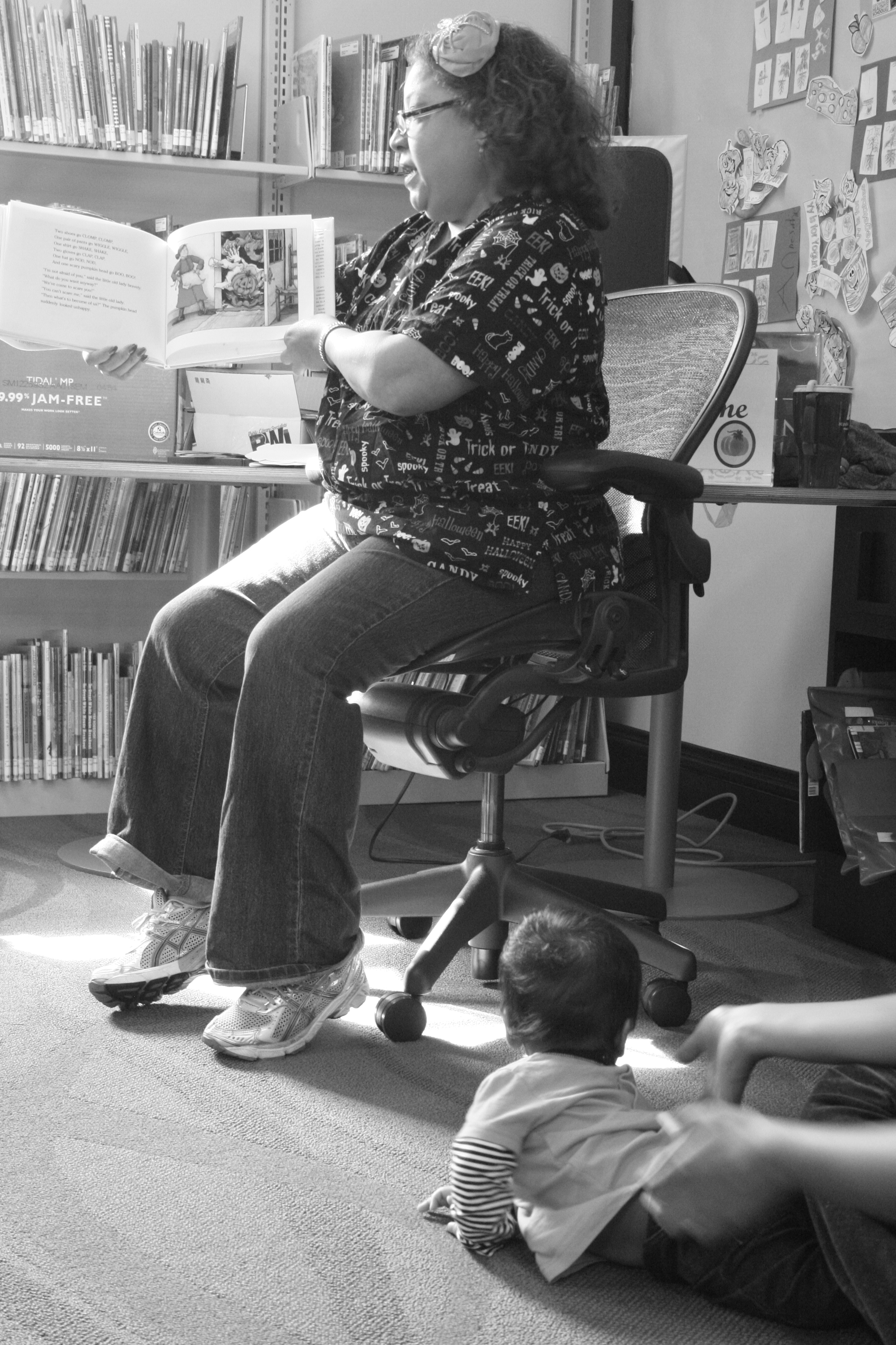 Boy listens as Miss Harris Reads a story