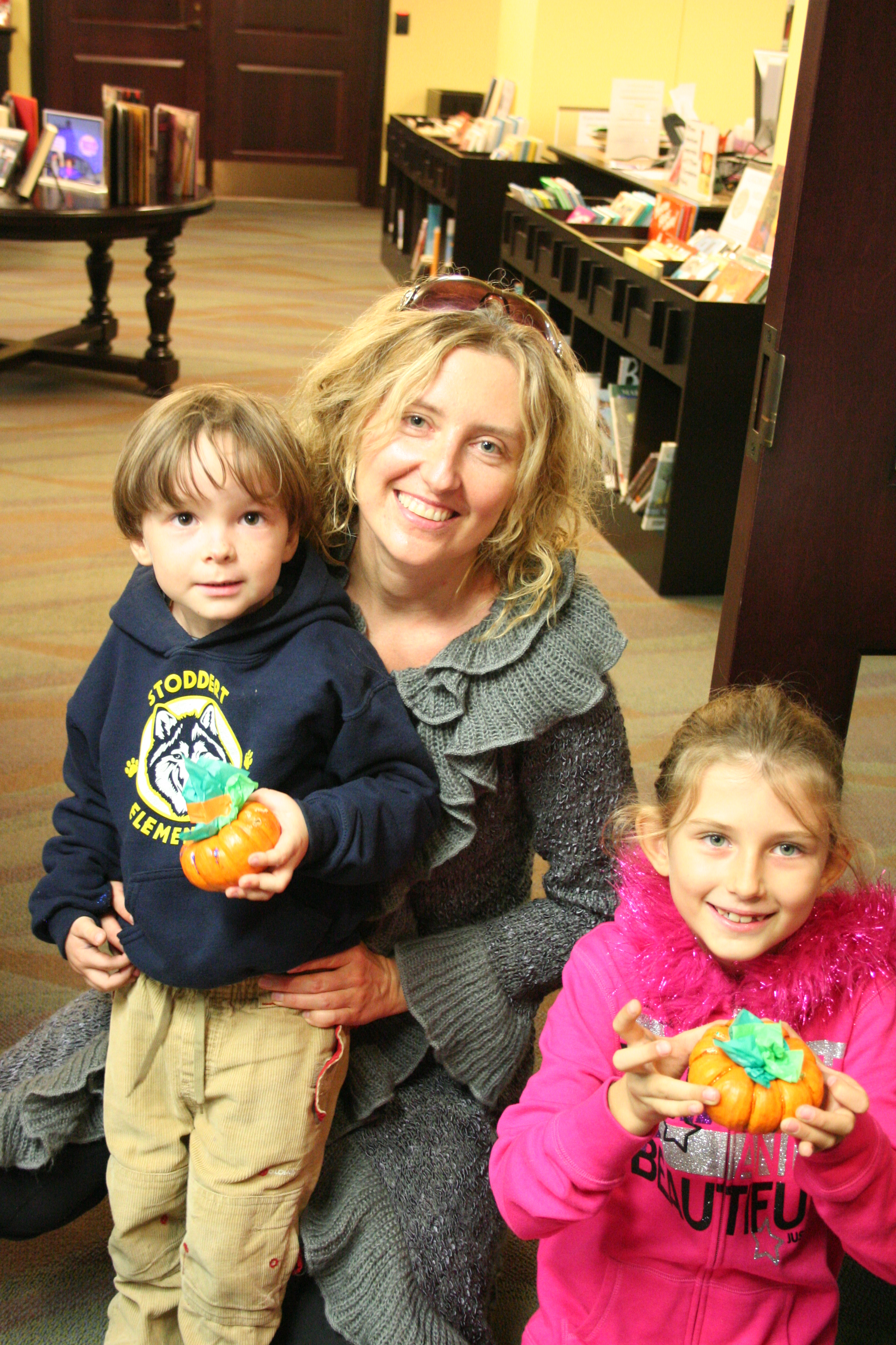 Family with their decorated pumpkins