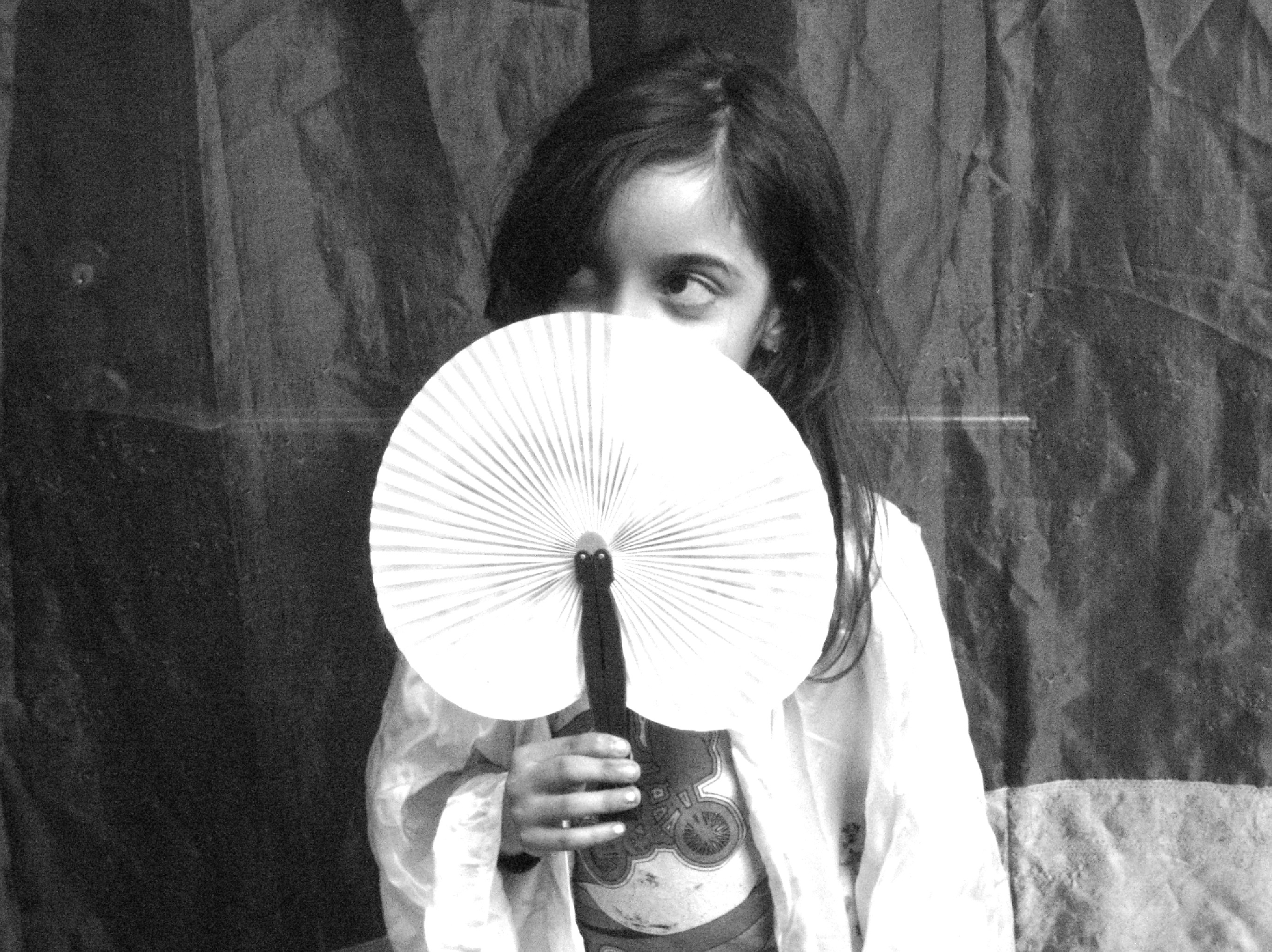 Girl posing with fan