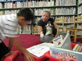 Photo of Pup-a-Roo the dog enjoying a story