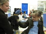 Photo of Pup-a-Roo the dog and a girl at the library