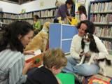 Photo of Quincy the dog hearing a story