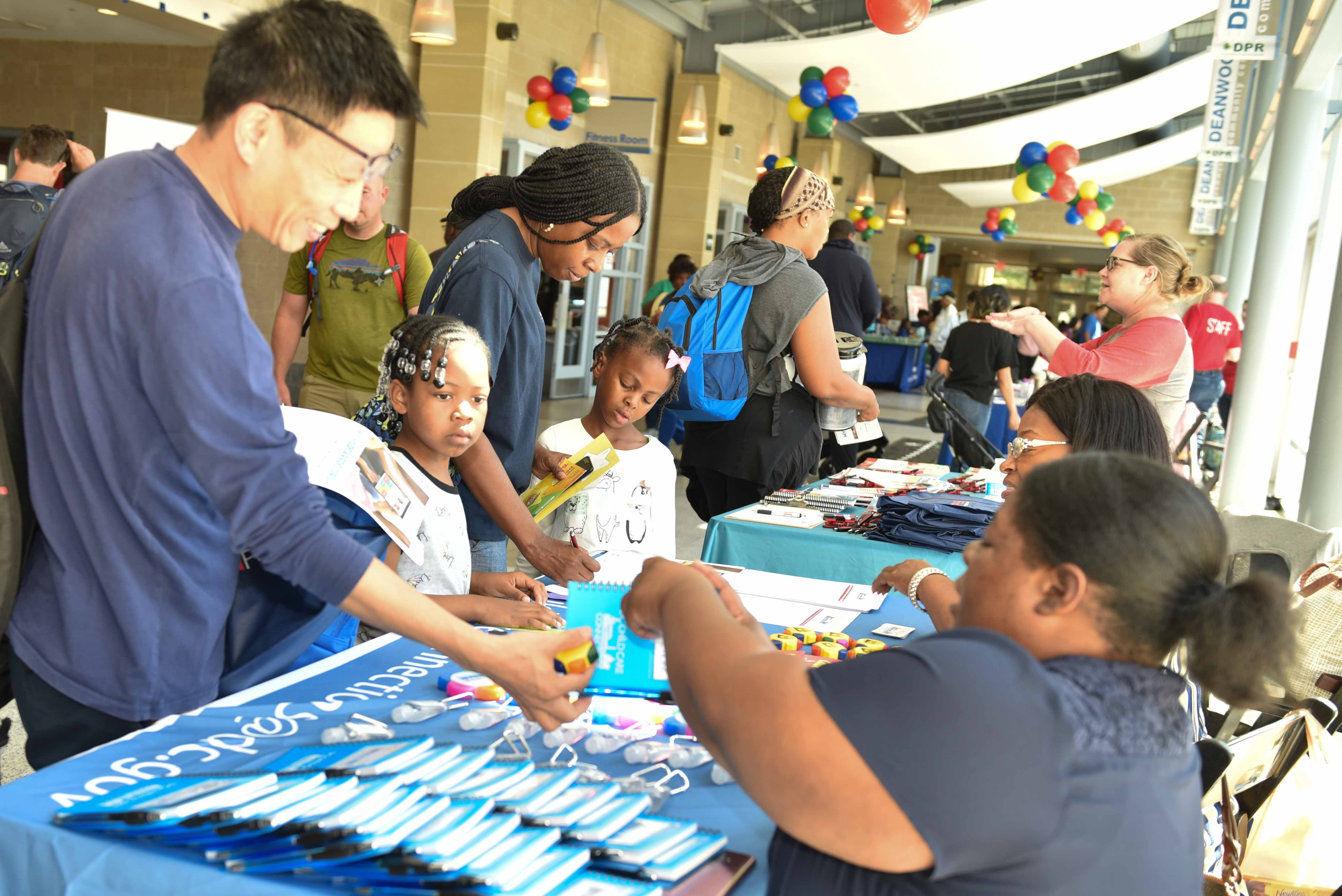 Families interact with community partners at the STAR Festival