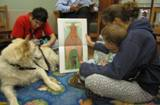 Photo of Snowball the dog hearing a story at the library
