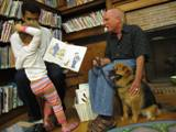 Photo of Trudy the dog listening to a story at the library