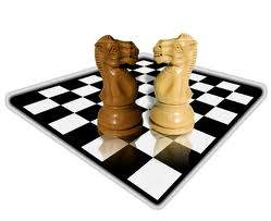 Two knights, chess pieces, are facing each other on a chess board