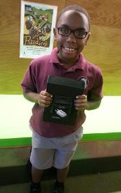 Darren B., our Dig Into Reading winner, with his new Kindle Fire.
