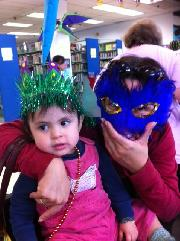 Mother and Child in Mardi Gras masks and crowns