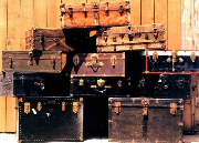 Image of a pile of suitcases and trunks.