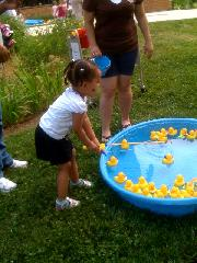 Summer Reading Kickoff Party, girl with duck pool