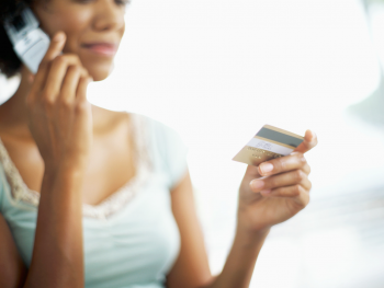 Image of Woman on Phone with Credit Card