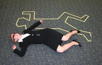Library Associate next to the body outline