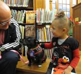 Ava the dog with a girl at the library