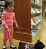 Ava the dog going for a walk with a girl at the library