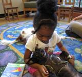 Photo of Ava the dog with a girl at the library