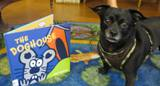Photo of Ava the dog choosing her book to read at the library
