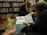 Photo of Bailey the dog reading with a family
