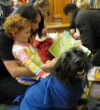 Photo of Buster the dog listening to a story