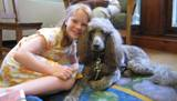 Photo of Ella the dog and a new friend at the library