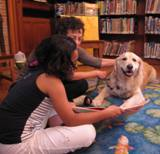 Photo of Leo the dog and a girl at the library