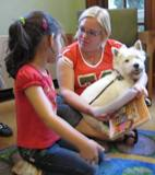 Photo of Pablo and a girl reading at the library