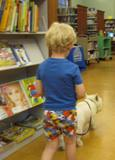 Photo of Pablo the dog going for a walk with a boy at the library