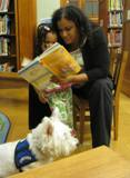Photo of Pablo and a family reading at the library