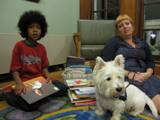 Photo of Pablo the dog selecting a book to hear at the library