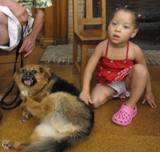 Photo of Trudy the dog and a girl at the library