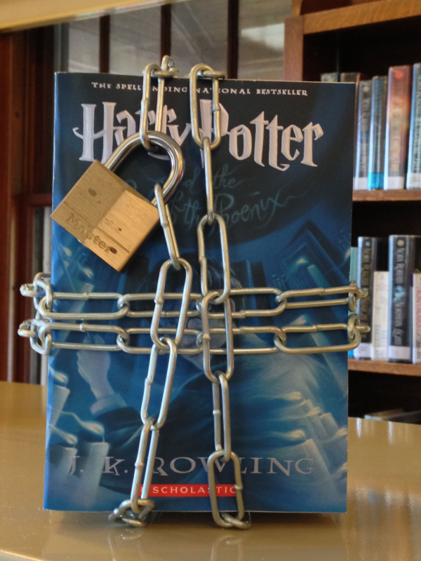 A Harry Potter book with chains and lock around it