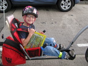 Child on Bike with Book