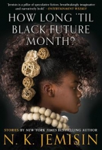 An image of the profile of a young, dark skinned Black woman with large stone beads around her neck and fossil balls in her curly black hair.