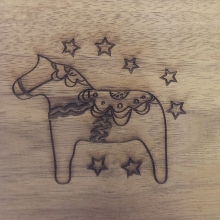 Laser cut horse on wood